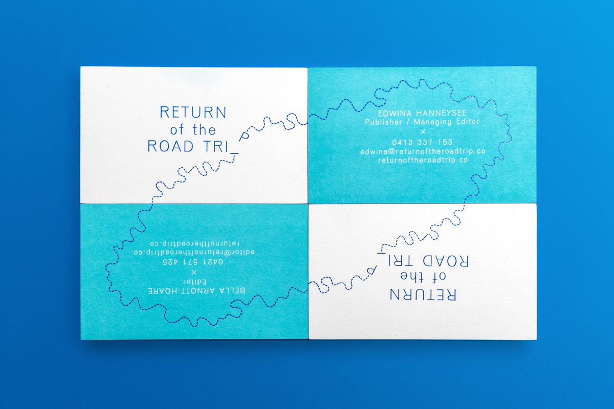 Return Of The Road Trip business cards with cobalt foiling and edge gilding.
